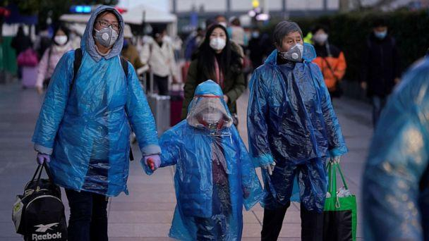 PHOTO: People wear face masks and plastic raincoats as a protection from coronavirus at Shanghai railway station, in Shanghai, China, Feb. 17, 2020. (Aly Song/Reuters)