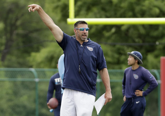 FILE - In this June 13, 2018, file photo, Tennessee Titans head coach Mike Vrabel gestures as players warm up during NFL football minicamp in Nashville, Tenn. Vrabel has impressed the Tennessee Titans and his new coaching staff with his energy and enthusiasm. Now new head coach faces the challenge of building on his first offseason, and expectations couldn't be much higher. (AP Photo/Mark Humphrey, File)
