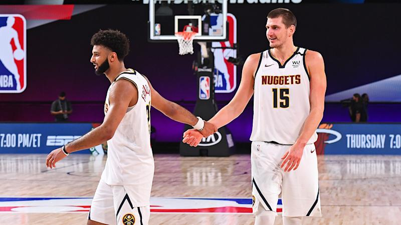 Jamal Murray and Nikola Jokic are pictured celebrating after the game.