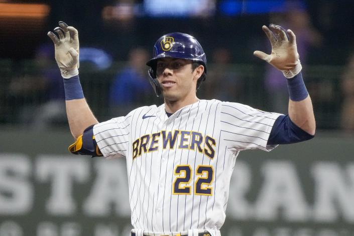 Milwaukee Brewers' Christian Yelich reacts after hitting a two-run scoring double during the seventh inning of a baseball game against the Pittsburgh Pirates Friday, June 11, 2021, in Milwaukee. (AP Photo/Morry Gash)