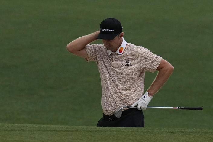 Justin Rose, of England, reacts after his chip shot out of a bunker on the 16th hole during the third round of the Masters golf tournament on Saturday, April 10, 2021, in Augusta, Ga. (AP Photo/Gregory Bull)