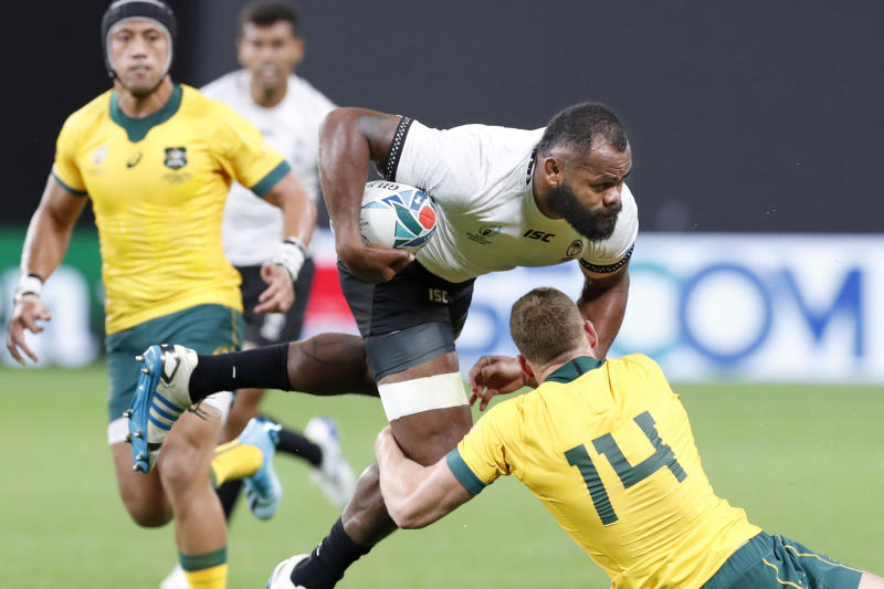 Fiji's Peceli Yato is tackled by Australia's Reece Hodge (14) during the Rugby World Cup Pool D game at Sapporo Dome between Australia and Fiji in Sapporo, northern Japan, Saturday, Sept. 21, 2019. (Masanori Takei/Kyodo News via AP)