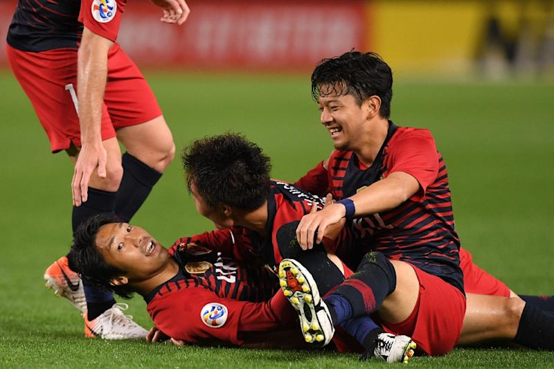 Hero super-sub: Sho Ito (second left is mobbed by teammates after scoring against Shandong Luneng (AFP Photo/Toshifumi KITAMURA)