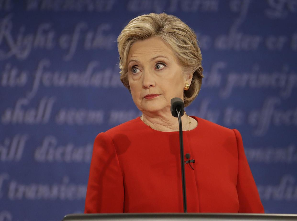 Hillary Clinton listens to Donald Trump during the presidential debate at Hofstra University. (Photo: Julio Cortez/AP)