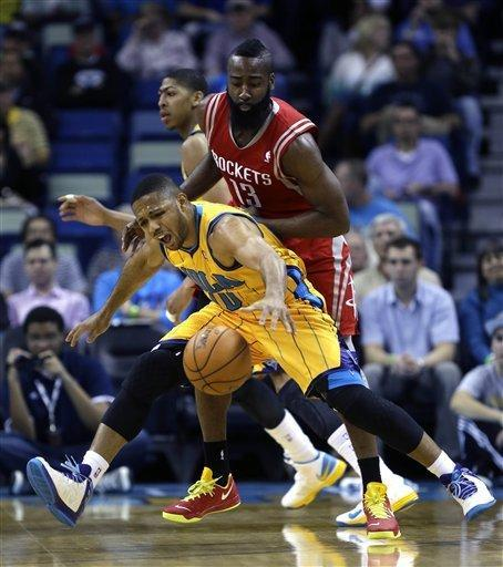 New Orleans Hornets guard Eric Gordon (10) reacts as he is fouled by Houston Rockets guard James Harden (13) in the first half of an NBA basketball game in New Orleans, Friday, Jan. 25, 2013. (AP Photo/Gerald Herbert)