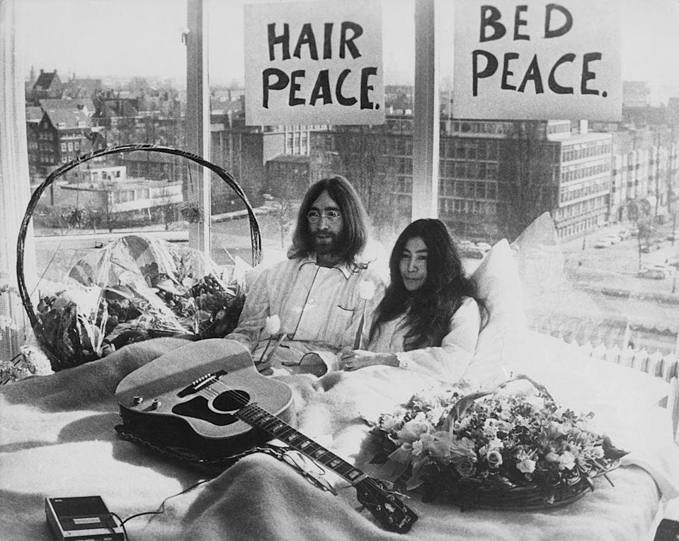 John Lennon and his wife of a week, Yoko Ono, in their bed in the Hilton Hotel, Amsterdam, in 1969Getty