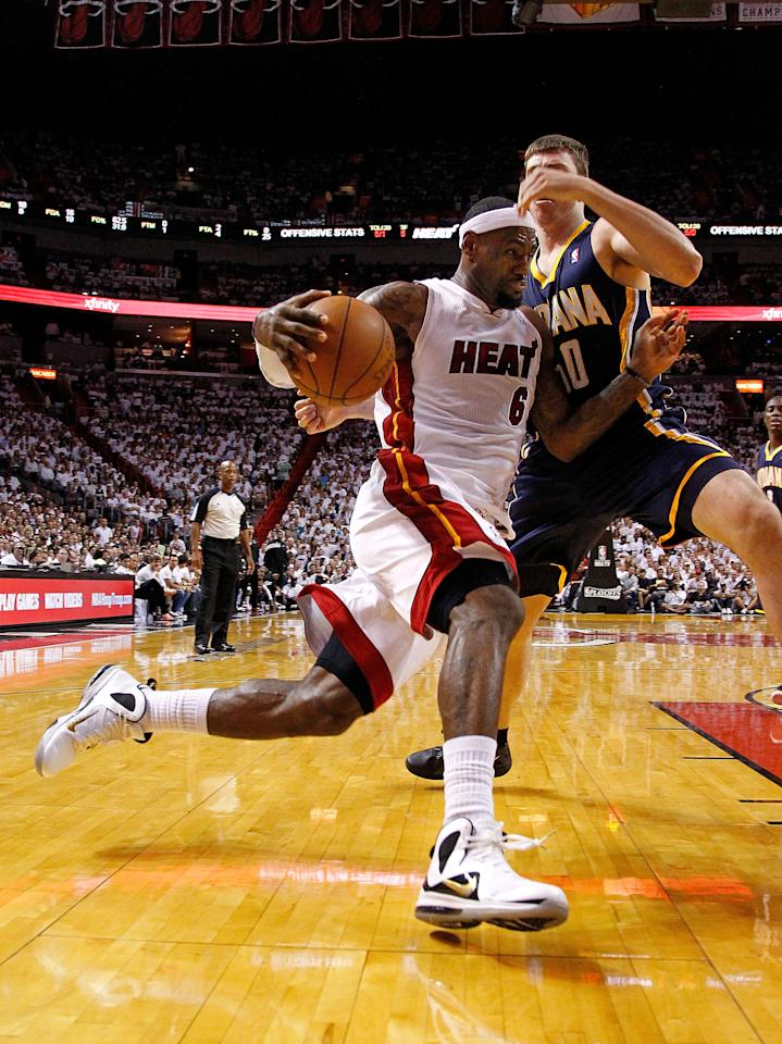 MIAMI, FL - MAY 22: LeBron James #6 of the Miami Heat drives on Tyler Hansbrough #50 of the Indiana Pacers during Game Five of the Eastern Conference Semifinals in the 2012 NBA Playoffs  at AmericanAirlines Arena on May 22, 2012 in Miami, Florida. NOTE TO USER: User expressly acknowledges and agrees that, by downloading and/or using this Photograph, User is consenting to the terms and conditions of the Getty Images License Agreement.  (Photo by Mike Ehrmann/Getty Images)