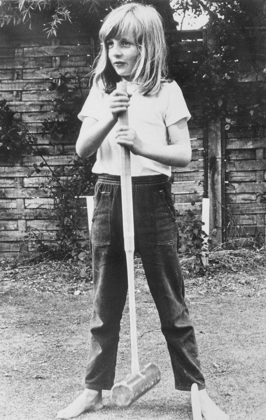 <p>A barefoot Diana poses with a croquet mallet while on holiday in Itchenor, West Sussex.</p>
