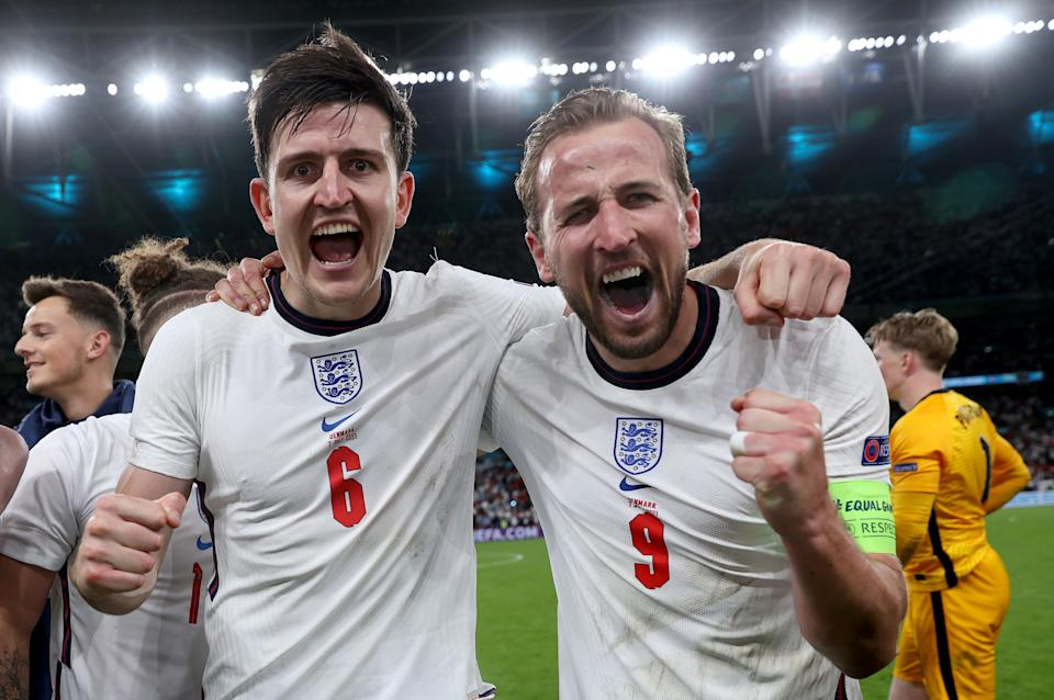 Harry Maguire and Harry Kane celebrate England's victory in their semi-final match against Denmark at Wembley on Wednesday