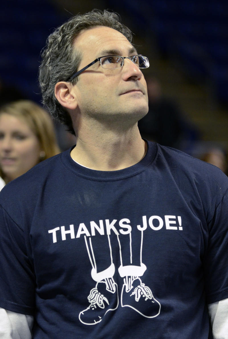 Rick Musar, of State College, Pa.,  pauses before a moment of silence in honor of former Penn State football coach Joe Paterno before an NCAA women's basketball game between Penn State and Iowa, Sunday, Jan. 22, 2012, in State College. Paterno died Sunday at the age of 85. (AP Photo/John Beale)