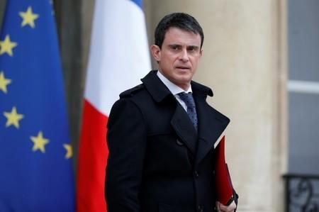 French Prime Minister Manuel Valls leaves after he attended a defence council at the Elysee Palace in Paris