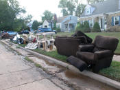 This Friday Sept. 3, 2021 photo shows ruined household possessions at the curb in Manville N.J. two days after the remnants of Tropical Storm Ida caused massive flooding in the New Jersey town near the Raritan River. (AP Photo/Wayne Parry)