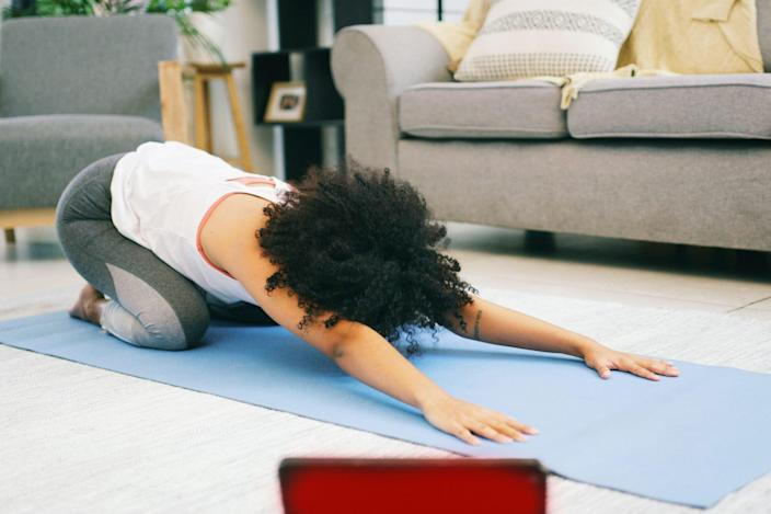 practicing yoga in living room