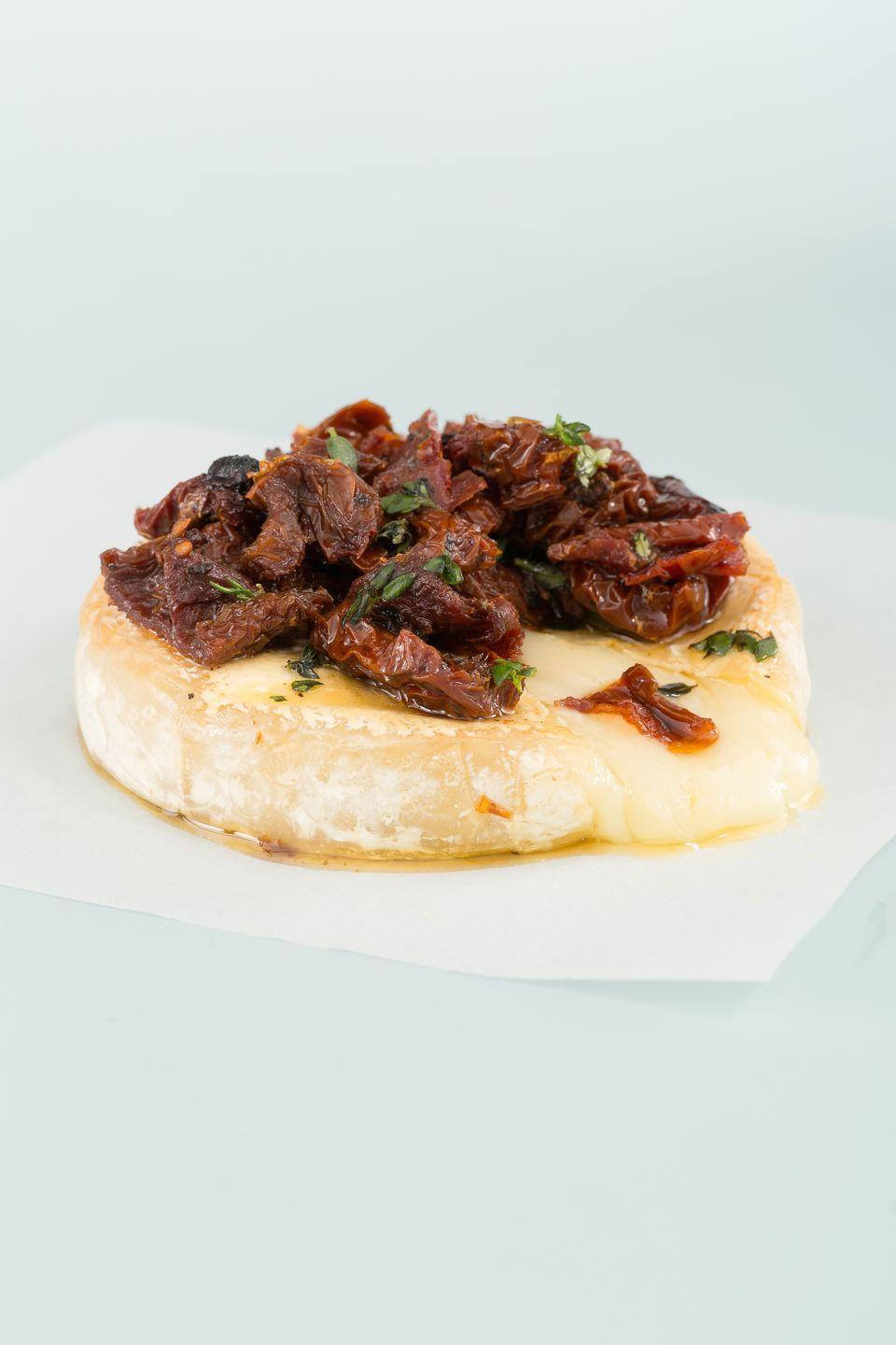 """<p>It sounds fancy, but you won't believe how stupid easy it is to make.</p><p>Get the recipe from <a href=""""https://www.delish.com/cooking/recipe-ideas/recipes/a44695/baked-brie-sundried-tomatoes-thyme-recipe/"""" rel=""""nofollow noopener"""" target=""""_blank"""" data-ylk=""""slk:Delish"""" class=""""link rapid-noclick-resp"""">Delish</a>.</p>"""