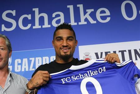Schalke 04's new player Kevin Prince Boateng poses after a news conference in Gelsenkirchen August 30, 2013. REUTERS/Ina Fassbender