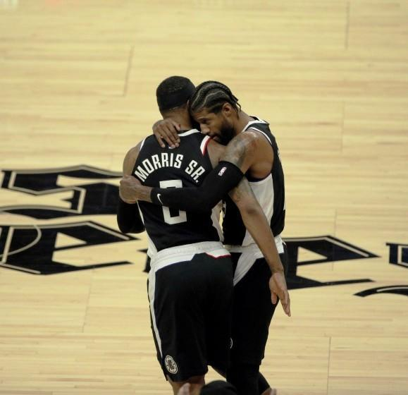 The Clippers' Paul George, right, hugs teammate Marcus Morris after George hit a three-pointer in Game 3 on June 12, 2021.