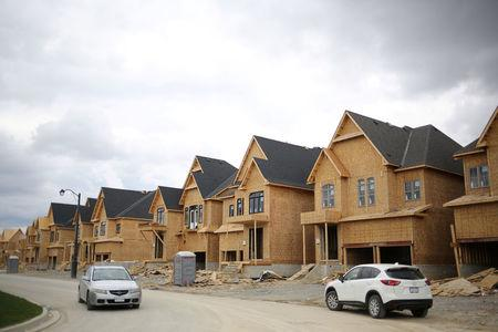 FILE PHOTO: A row of houses under construction are seen at a subdivision near the town of Kleinburg