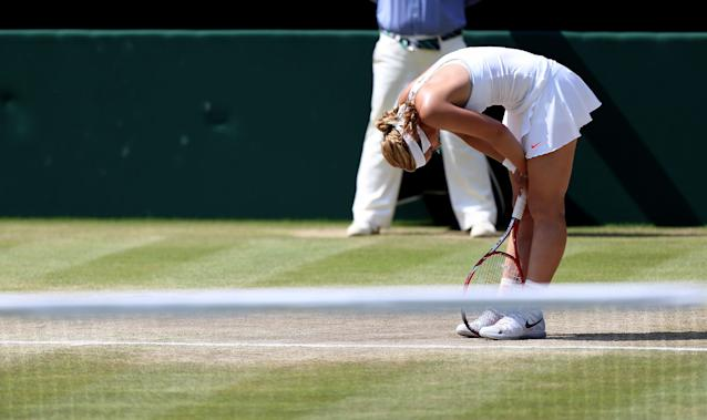 Germany's Sabine Lisicki reacts during her match against France's Marion Bartoli during day twelve of the Wimbledon Championships at The All England Lawn Tennis and Croquet Club, Wimbledon.