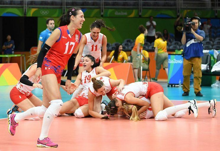 Serbia's players react after winning the women's semi-final volleyball match against USA at the Maracanazinho stadium in Rio de Janeiro on August 18, 2016, during the Rio 2016 Olympic Games. / AFP / Eric FEFERBERG (Photo credit should read ERIC FEFERBERG/AFP/Getty Images)