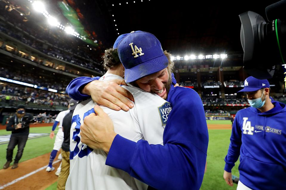 ARLINGTON, TX - OCTOBER 27:  Clayton Kershaw #22 and Cody Bellinger #35 of the Los Angeles Dodgers celebrate on the field after defeating the Tampa Bay Rays in Game 6 to clinch the 2020 World Series at Globe Life Field on Tuesday, October 27, 2020 in Arlington, Texas. (Photo by Alex Trautwig/MLB Photos via Getty Images)