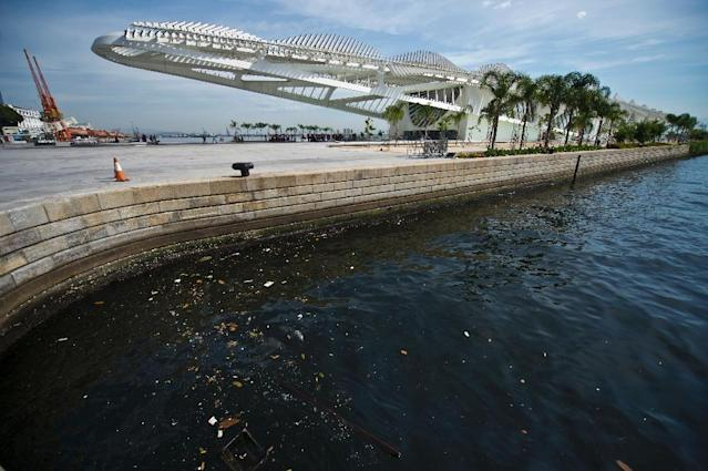 Raw sewage and garbage litter Rio's Guanabara Bay, pictured here near the Museu do Amanha (Museum of Tomorrow) in Rio de Janeiro, Brazil, on April 26, 2016. (AFP Photo/Vanderlei Almeida)