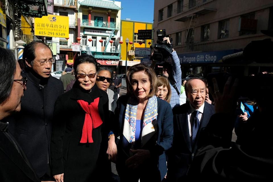 House Speaker Nancy Pelosi (D-Calif.), walks with Florence Fang, second from left, to a temple during a tour of Chinatown on Monday, Feb. 24, in San Francisco.Pelosi chatted with shop owners and took a walking tour of the local Chinatown in an effort to let people know the neighborhood is safe and would welcome their support. (Photo: Eric Risberg/AP Photo)