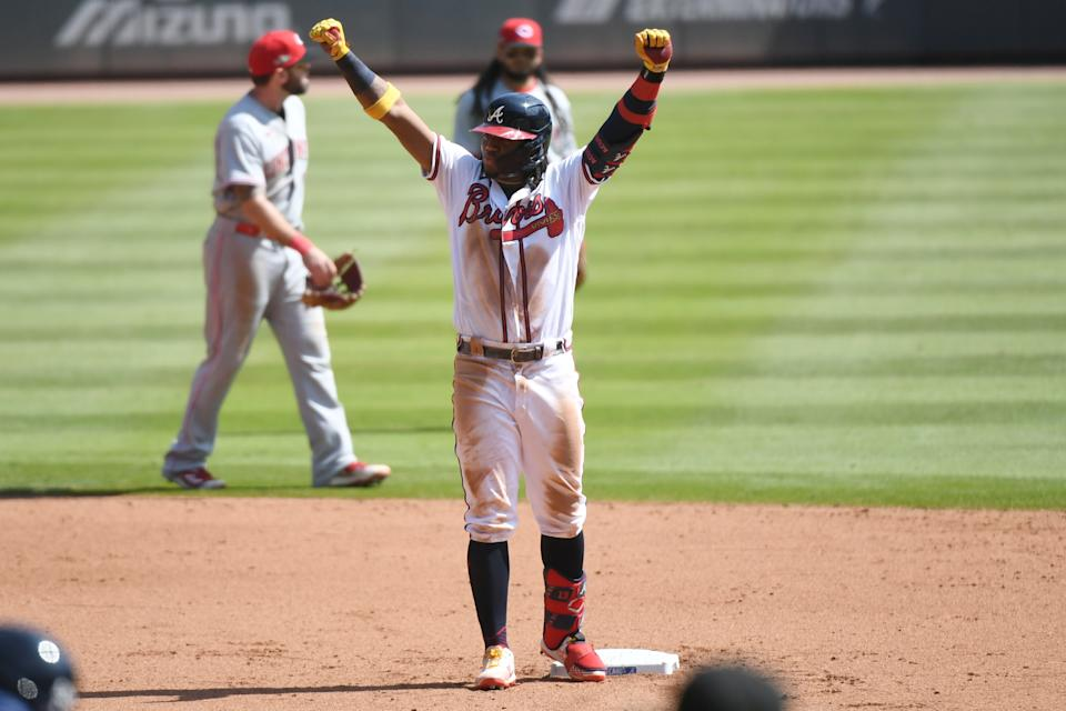 Ronald Acuña Jr.  and the Braves are moving on after sweeping the Reds. (Photo by Adam Hagy/MLB Photos via Getty Images)