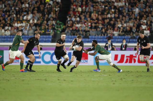 New Zealand's Beauden Barrett tries to avoid a tackle during the Rugby World Cup Pool B game between New Zealand and South Africa in Yokohama, Japan, Saturday, Sept. 21, 2019. (AP Photo/Shuji Kajiyama)