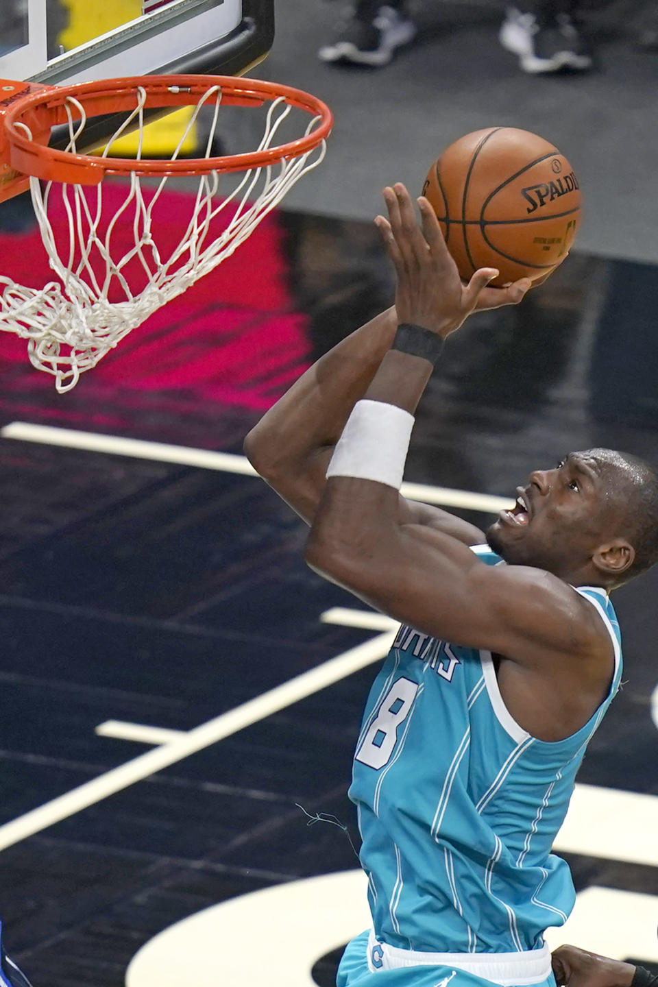 Charlotte Hornets center Bismack Biyombo takes a shot against the Orlando Magic during the second half of an NBA basketball game, Monday, Jan. 25, 2021, in Orlando, Fla. (AP Photo/John Raoux)