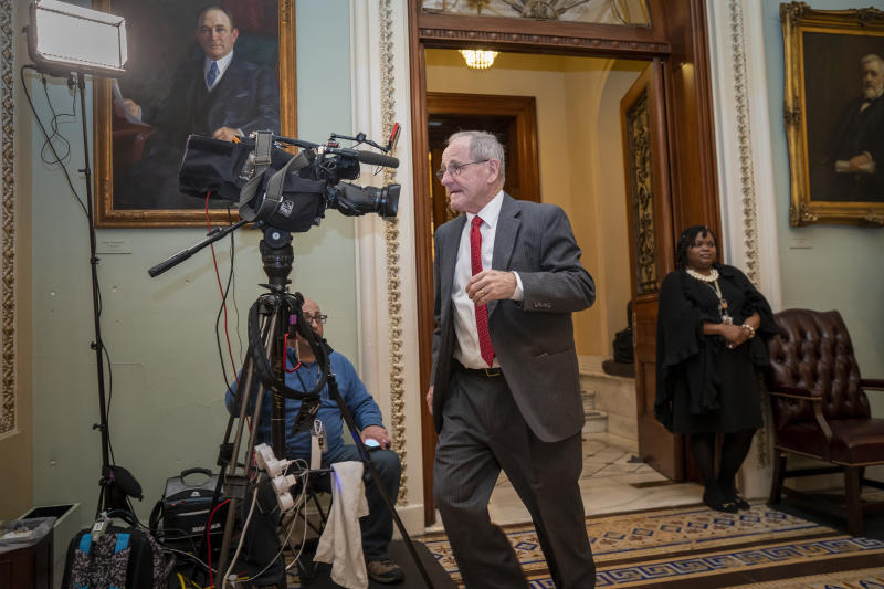 File - In this Jan. 21, 2020, file photo, Sen. Jim Risch, R-Idaho, leaves the Senate chamber during the impeachment trial of President Donald Trumpat the Capitol in Washington. The seven House Democratic impeachment managers have used long speeches to explain why President Donald Trump should be removed from office. Republican senators sitting through their chamber's trial largely considered Democrats' arguments tedious and unpersuasive. (AP Photo/J. Scott Applewhite, File)