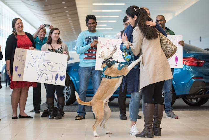 Iranian engineer Nazanin Zinouri, with her dog Dexter, gets a hug from Emma Porter after arriving at the Greenville Spartanburg Airport Feb. 6, 2017 in Greenville, South Carolina. Zinouri, a Clemson graduate, works for a technology firm in Greenville and has lived in the United States for the past seven years. While attempting to return to South Carolina after a recent trip visiting family in Iran, she had been taken off her flight in Dubai as a result of Trump's travel and immigrationorder.
