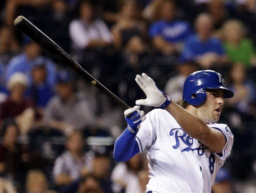 Kansas City Royals' Mike Moustakas hits an RBI double during the eighth inning of a baseball game against the Detroit Tigers, Tuesday, Aug. 28, 2012, in Kansas City, Mo. The Royals won 9-8. (AP Photo/Charlie Riedel)