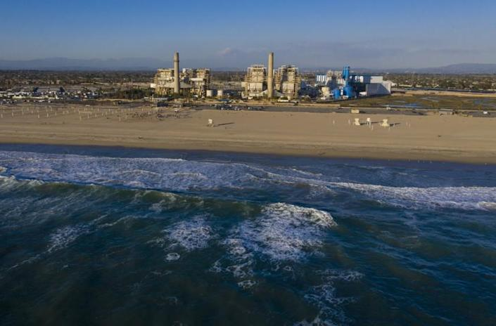 HUNTINGTON BEACH, CA - February 17: A view of the older AES Huntington Beach Power Station at left, and new one at right, and is the proposed site of the Poseidon Desalination Plant, which would draw ocean water through an existing intake pipe at Wednesday, Feb. 17, 2021 in Huntington Beach, CA. (Allen J. Schaben / Los Angeles Times)