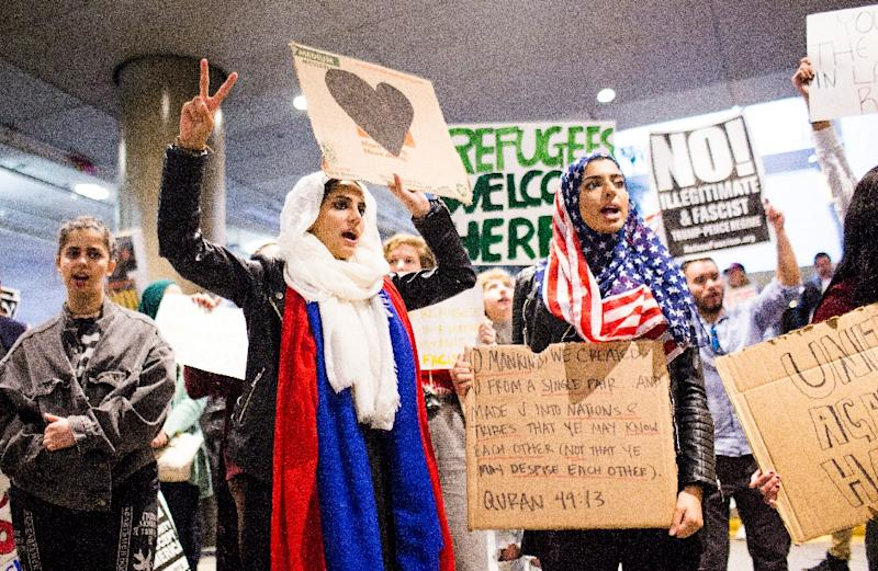 Demonstrators protest the executive order by US President Donald Trump banning immigrants from seven majority-Muslim countries at Los Angeles International Airport (AFP Photo/Kyle Grillot)