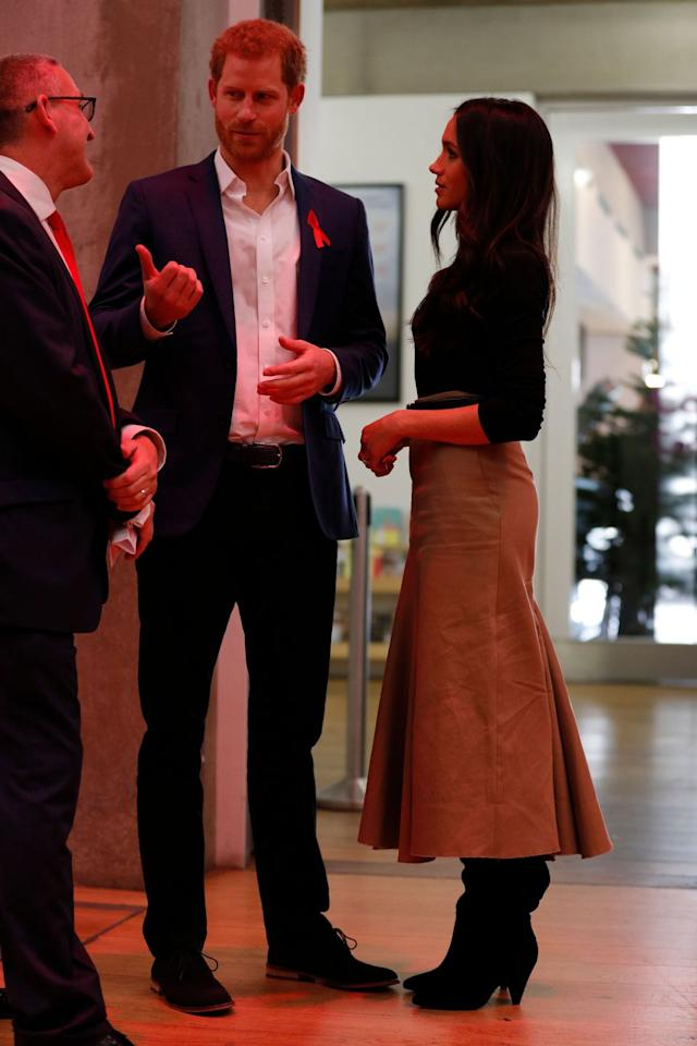 """<p>A look at Meghan's outfit without her coat on during her first royal visit to Nottingham. Her boots are <a href=""""https://www.kurtgeiger.com/women/shoes/boots/over-the-knee-boots/violet-black-suede-kg-kurt-geiger?"""" target=""""_blank"""">KG Kurt Geiger's """"Violet"""" over-the-knee boots</a>. </p>"""