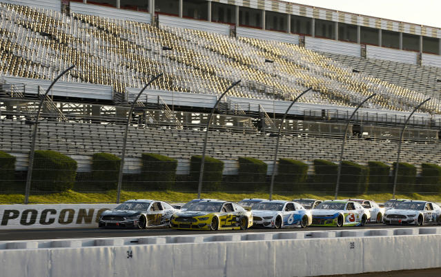 The field lines up for a restart during the NASCAR Cup Series auto race at Pocono Raceway, Sunday, June 28, 2020, in Long Pond, Pa. (AP Photo/Matt Slocum)