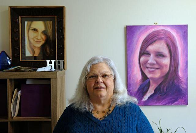 Susan Bro poses with a photo and portrait of her daughter, Heather Heyer, on Dec. 13, 2017. (Photo: Norm Shafer for the Washington Post via Getty Images)