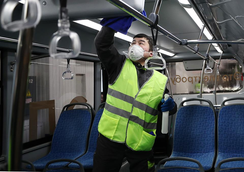 MOSCOW, RUSSIA - MARCH 3, 2020: An employee disinfecting an electric bus at Moscow's trolleybus depot No 6. Moscow's public transport ranks one of the cleanest and most sanitary in the world; both the bodies and the passenger compartments of buses, trams, electric buses and trolleybuses undergo wet cleaning every morning. Mikhail Tereshchenko/TASS (Photo by Mikhail Tereshchenko\TASS via Getty Images)