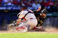 Pittsburgh Pirates' Colin Moran, right, is tagged out at home plate by Philadelphia Phillies' J.T. Realmuto (10) on a double hit by Ke'Bryan Hayes during the seventh inning of a baseball game, Sunday, Sept. 26, 2021, in Philadelphia. (AP Photo/Derik Hamilton)