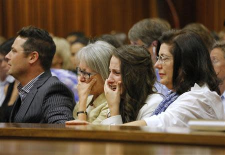 Aimee Pistorius (2nd R), sister of South African Olympic and Paralympic sprinter Oscar Pistorius cries as he gives evidence during his trial at the high court in Pretoria April 8, 2014. REUTERS/Kim Ludbrook/Pool