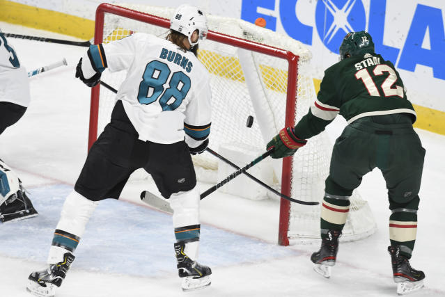 San Jose Sharks' Brent Burns (88) ties up the stick of Minnesota Wild's Eric Staal, right, as he attempts to get to the puck in the first period of an NHL hockey game, Saturday, Feb. 15, 2020, in St. Paul, Minn. (AP Photo/Tom Olmscheid)