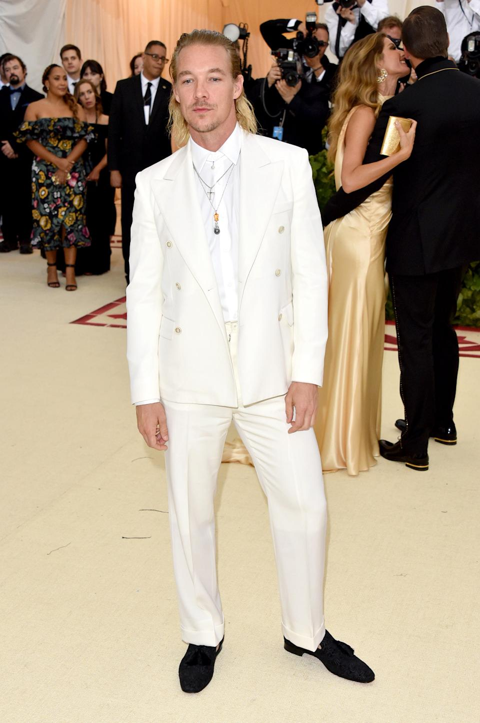 """<h1 class=""""title"""">Diplo in Maison Margiela, Christian Louboutin shoes, and Mikimoto jewelry</h1><cite class=""""credit"""">Photo: Getty Images</cite>"""