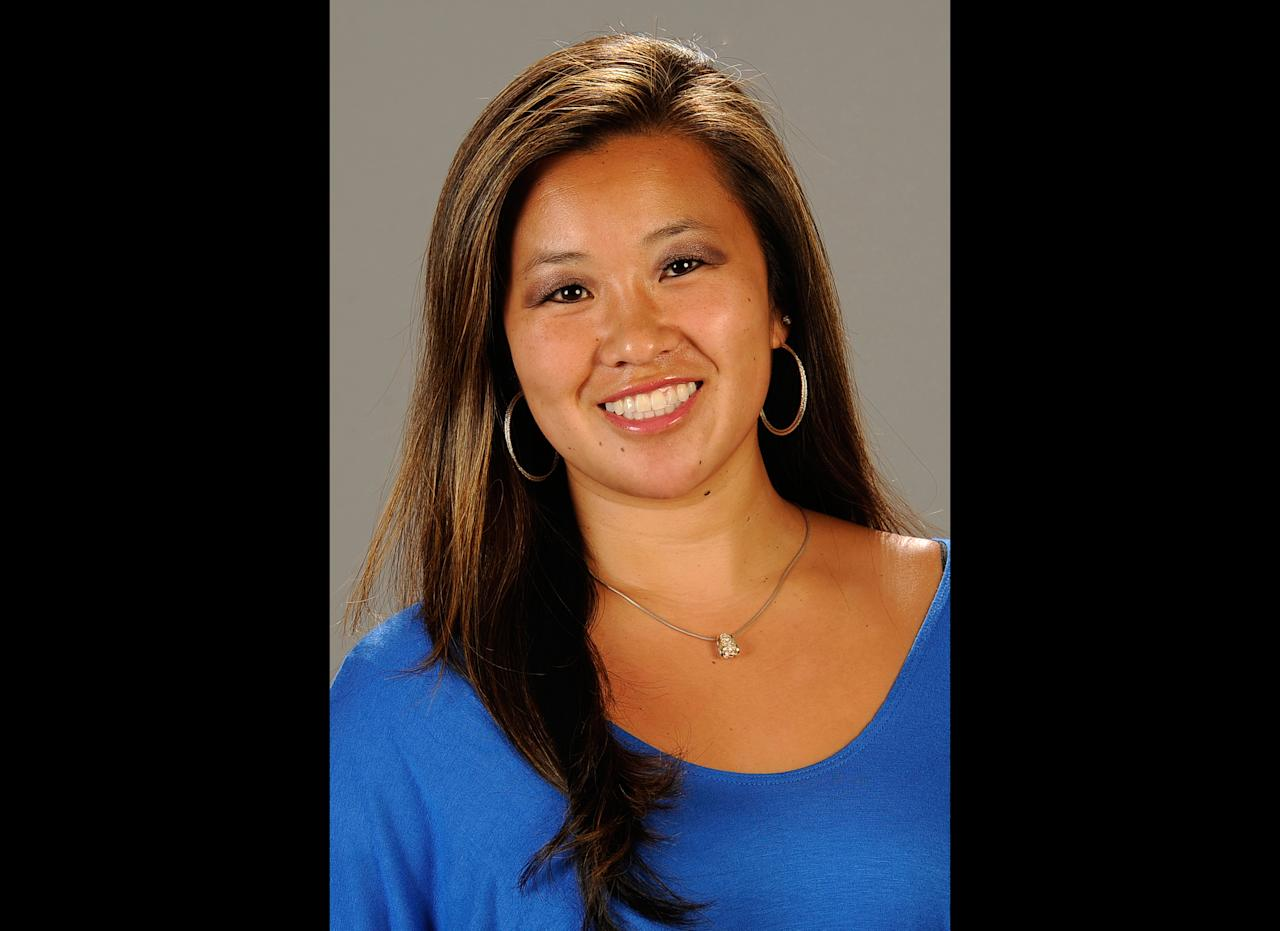 FILE - This undated file photo provided by Cal State Fullerton on Monday, Feb. 4, 2013, shows Cal State Fullerton assistant women's NCAA college basketball coach Monica Quan in Fullerton, Calif. Quan and her fiance Keith Lawrence were found shot to death Sunday night on the top floor of a parking structure at the complex, police said. Former LAPD officer and U.S. Navy reservist Christopher Jordan Dorner, 33, is a suspect in the killings. (AP Photo/Cal State Fullerton, File)