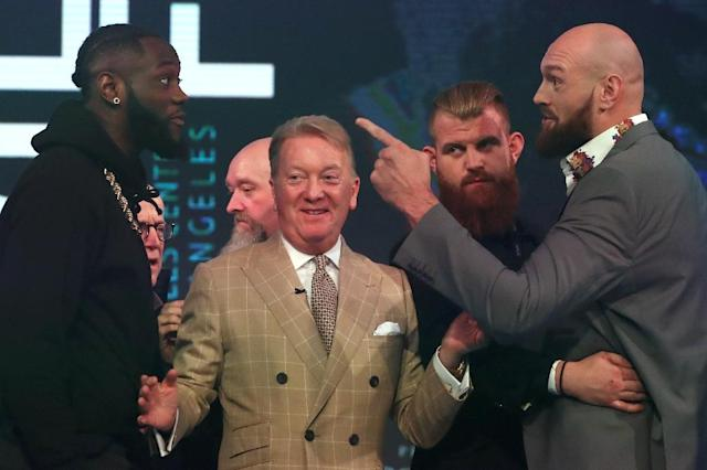 Deontay Wilder and Tyson Fury square off in London on Monday as promoter Frank Warren steps in (AFP Photo/Daniel LEAL-OLIVAS)