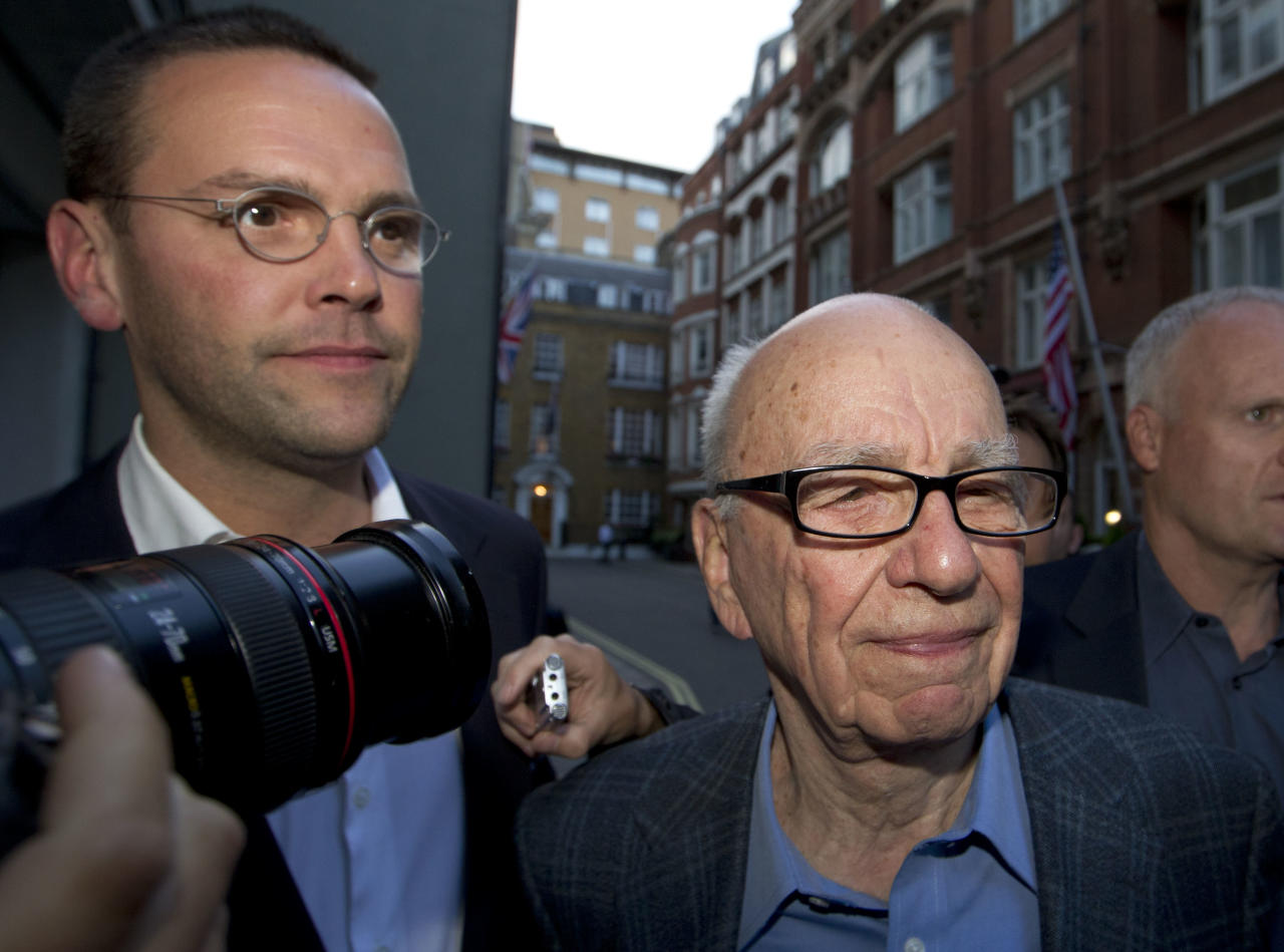 FILE This is a Sunday, July 10, 2011 file photo of Chairman of News Corporation Rupert Murdoch, right, and his son James Murdoch, chief executive of News Corporation Europe and Asia as they arrive at his residence in central London, Sunday, July 10, 2011. Rupert Murdoch's News Corp. says James Murdoch is stepping down as executive chairman of the company's U.K. newspaper arm. News Corp. said Wednesday Feb. 29, 2012 James Murdoch has relinquished his position at News International to focus on the company's international TV business. (AP Photo/Sang Tan)