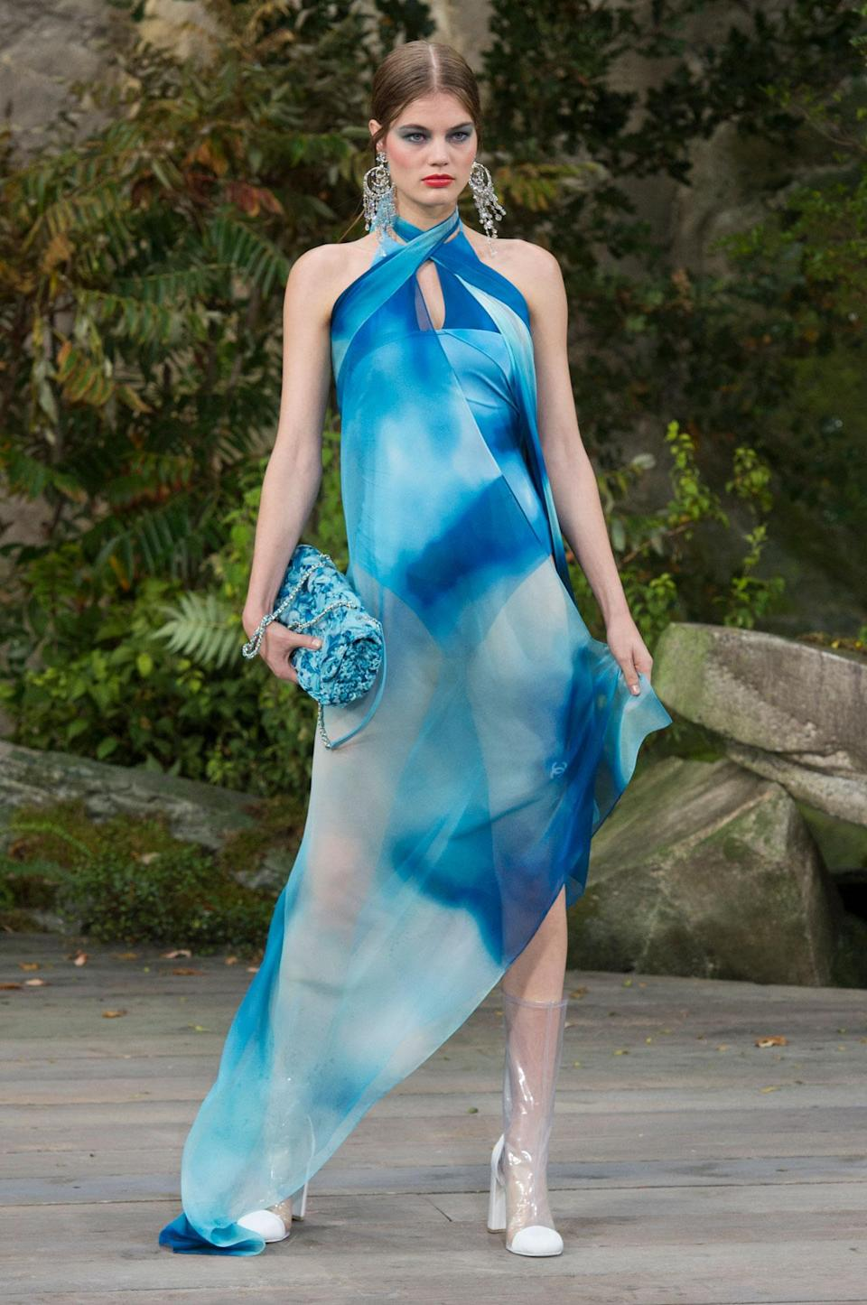 <p>Soft blue tie dye halter dress from the SS18 Chanel collection. (Photo: ImaxTree) </p>