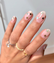 """Not only is this look pretty, but it's insanely easy to do. All you need are some <a href=""""https://oliveandjune.com/collections/nail-art-stickers/products/stars?variant=14335174377514"""" rel=""""nofollow noopener"""" target=""""_blank"""" data-ylk=""""slk:star stickers"""" class=""""link rapid-noclick-resp"""">star stickers</a> and a dependable <a href=""""https://shop-links.co/1724898186524185497"""" rel=""""nofollow noopener"""" target=""""_blank"""" data-ylk=""""slk:topcoat"""" class=""""link rapid-noclick-resp"""">topcoat</a>."""