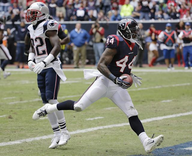 Houston Texans' Ben Tate (44) scores a touchdown against the New England Patriots during the first quarter of an NFL football game Sunday, Dec. 1, 2013, in Houston. (AP Photo/David J. Phillip)