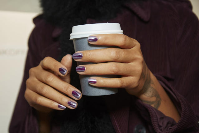 <p>Keeping in line with the rock and roll spirit of the collection, Michelle Saunders mastered an edgy-chic nail design with Dressed to the Nineties and Girly Grunge. (Photo: Essie) </p>