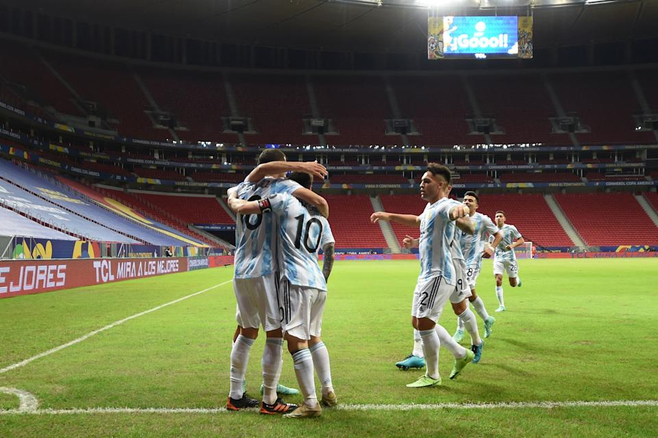 Argentina's Guido Rodriguez (L) celebrates with teammates after scoring against Uruguay during their Conmebol Copa America 2021 football tournament group phase match at the Mane Garrincha Stadium in Brasilia, on June 18, 2021. (Photo by EVARISTO SA / AFP) (Photo by EVARISTO SA/AFP via Getty Images)